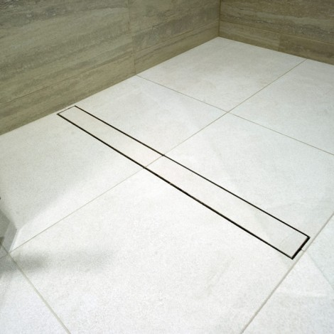 Linear drain with inset tile